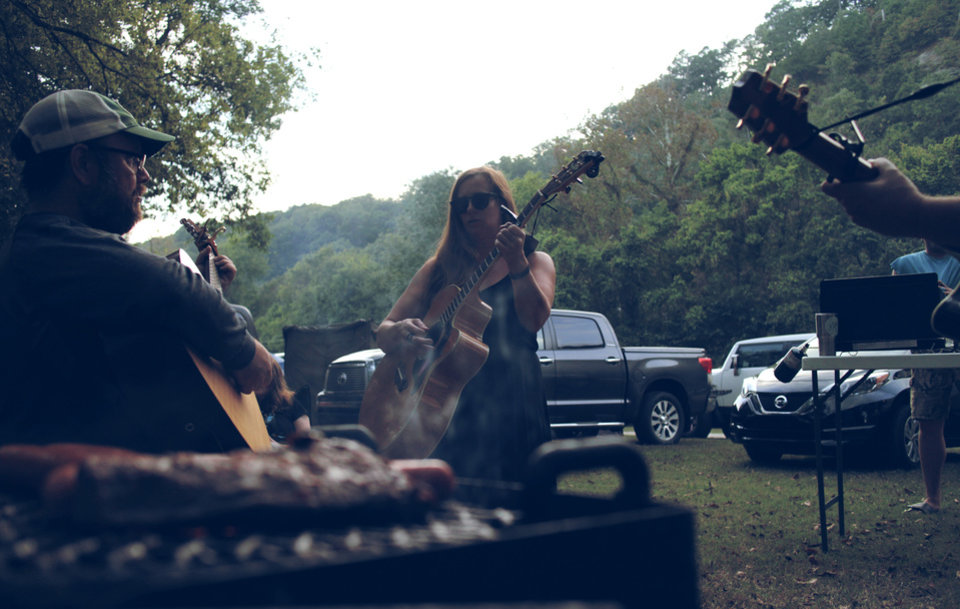 Photo -  Illinois River Jam patrons perform on the festival's campgrounds at the 2017 camping and music festival in Tahlequah. More than a dozen bands performed Sept. 29-30 at Peyton's Place, a secluded resort surrounded by countryside. [Photo by Nathan Poppe, The Oklahoman]
