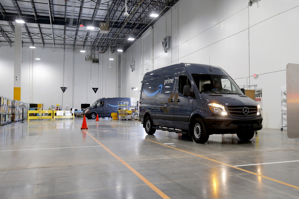 Photo - Delivery vans enter the new Amazon Delivery Center in Oklahoma City, Tuesday, Oct. 23, 2018. Photo by Bryan Terry, The Oklahoman