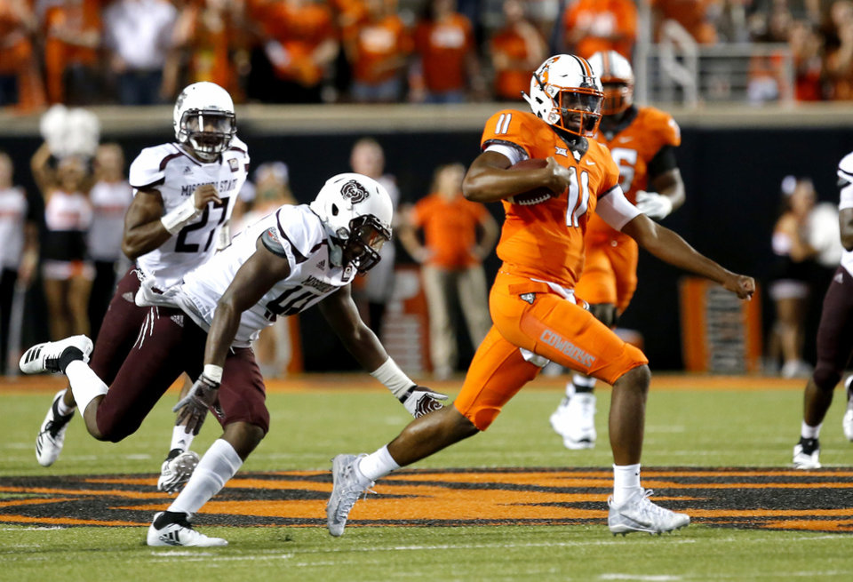 Photo - Oklahoma State's Keondre Wudtee (11) gets by Missouri State's Kevin Ellis (43) in the fourth quarter during a college football game between the Oklahoma State Cowboys (OSU) and the Missouri State Bears at Boone Pickens Stadium in Stillwater, Okla., Thursday, Aug. 30, 2018. Photo by Sarah Phipps, The Oklahoman