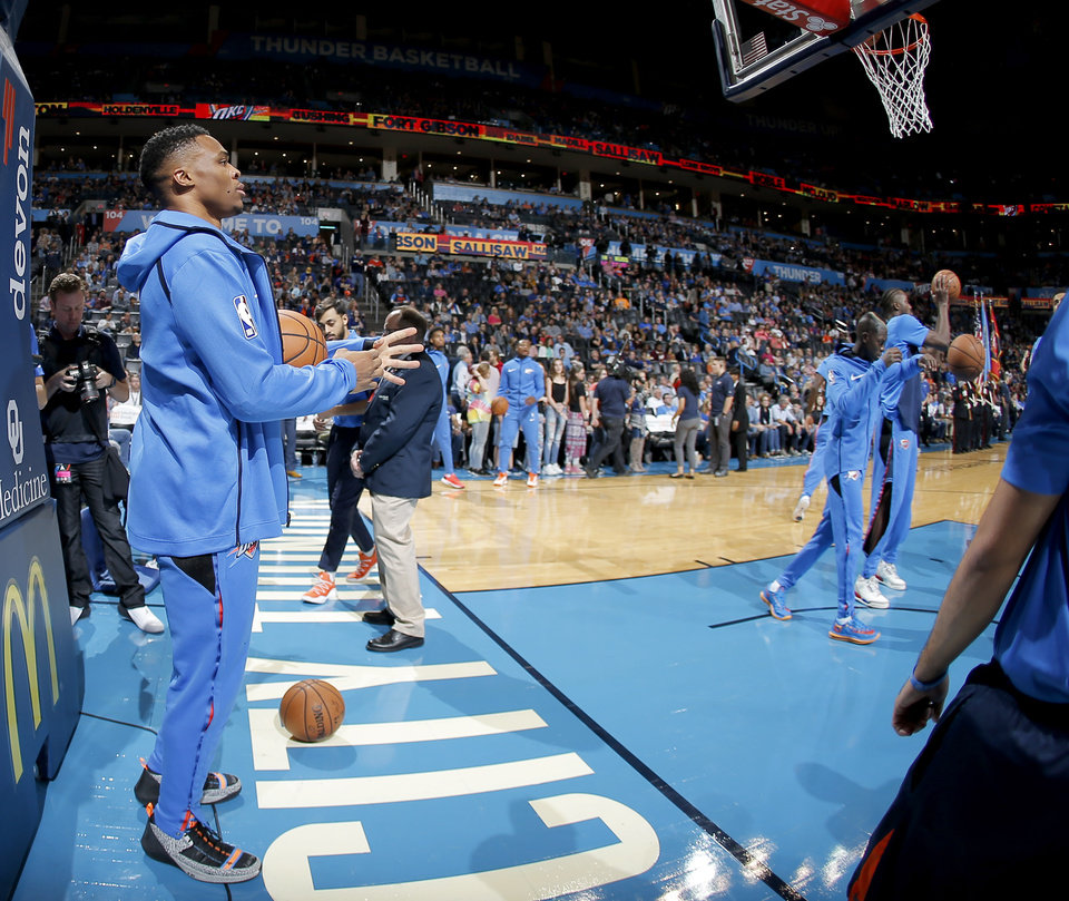 Photo - Oklahoma City's Russell Westbrook (0) stands off court before an NBA basketball game between the Oklahoma City Thunder and the Sacramento Kings at Chesapeake Energy Arena in Oklahoma City, Sunday, Oct. 21, 2018. Photo by Bryan Terry, The Oklahoman