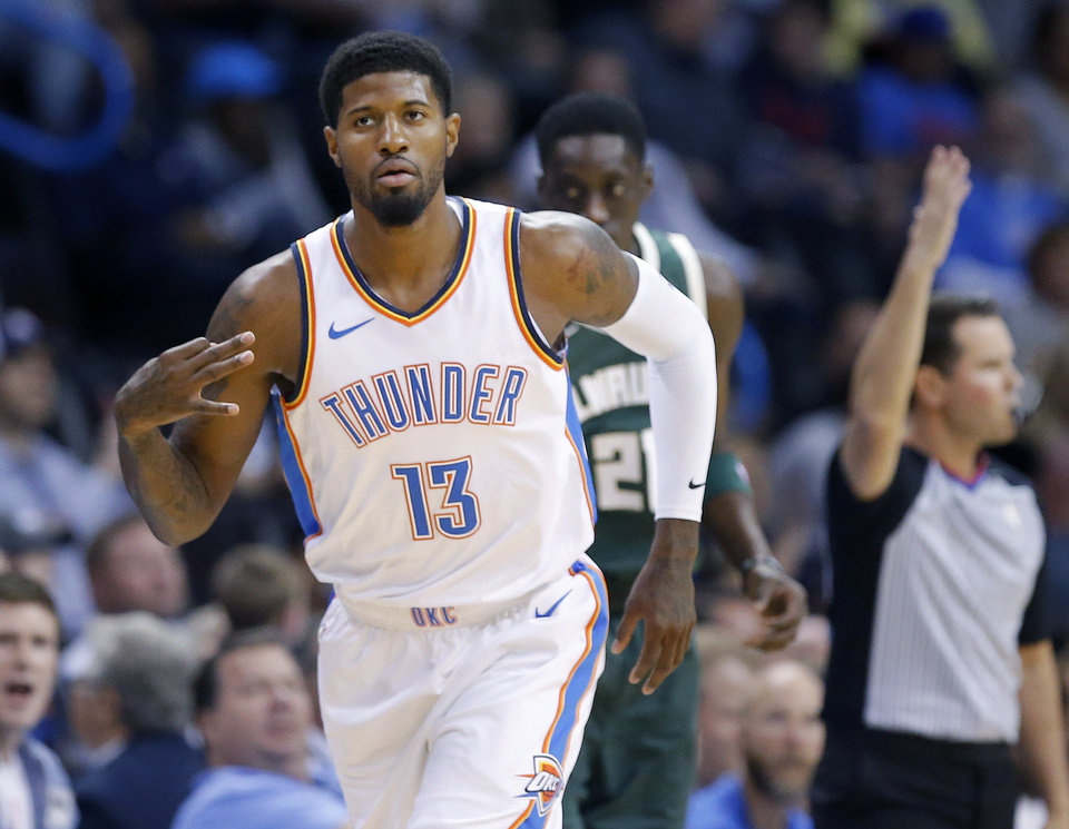 Photo -  Oklahoma City's Paul George (13) celebrates a 3-pointer Tuesday in a 119-115 overtime win over the Bucks. [Photo by Sarah Phipps, The Oklahoman]