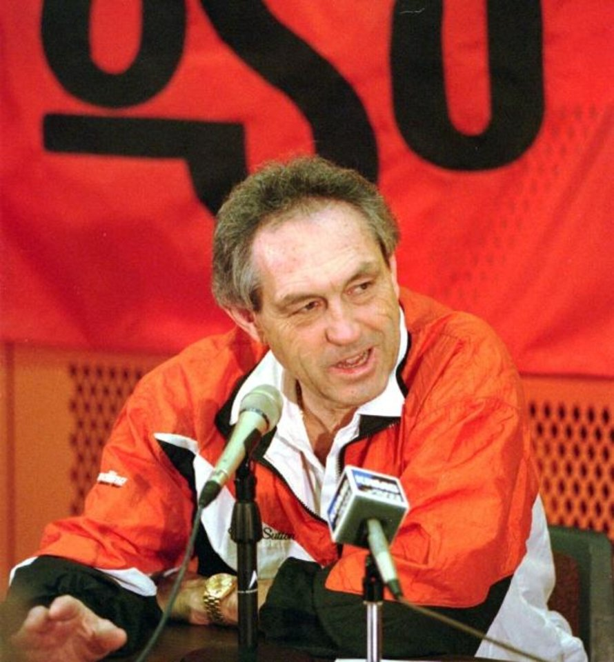 Photo -  Eddie Sutton answers questions before the 1995 Final Four trip. [OKLAHOMAN ARCHIVES]