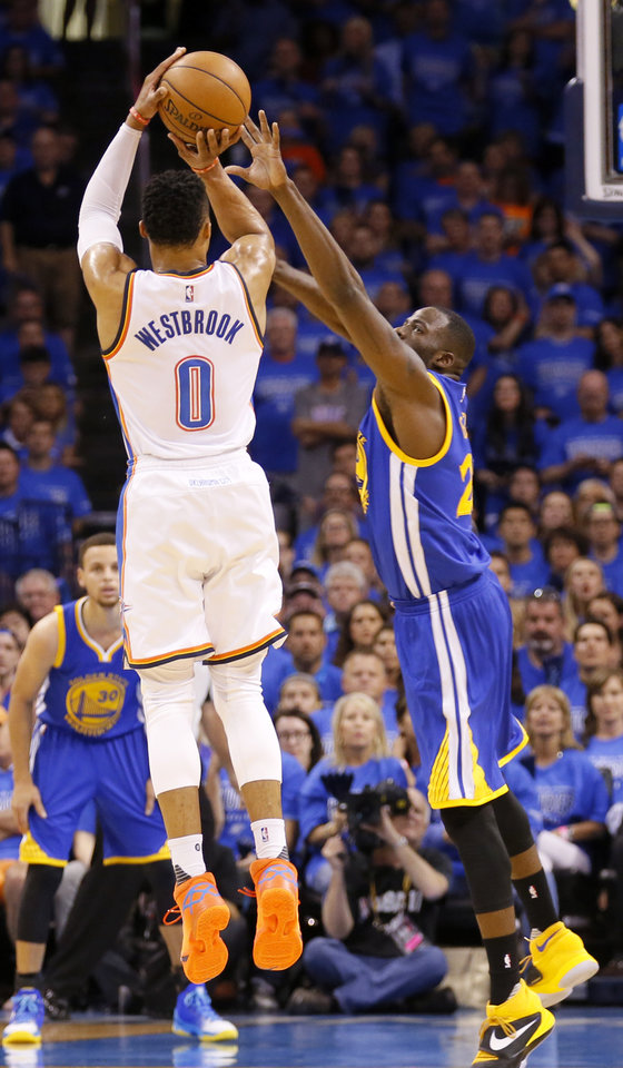 Photo - Oklahoma City's Russell Westbrook (0) shoots a 3-point basket over Golden State's Draymond Green (23) during Game 6 of the Western Conference finals in the NBA playoffs between the Oklahoma City Thunder and the Golden State Warriors at Chesapeake Energy Arena in Oklahoma City, Saturday, May 28, 2016. Photo by Sarah Phipps, The Oklahoman