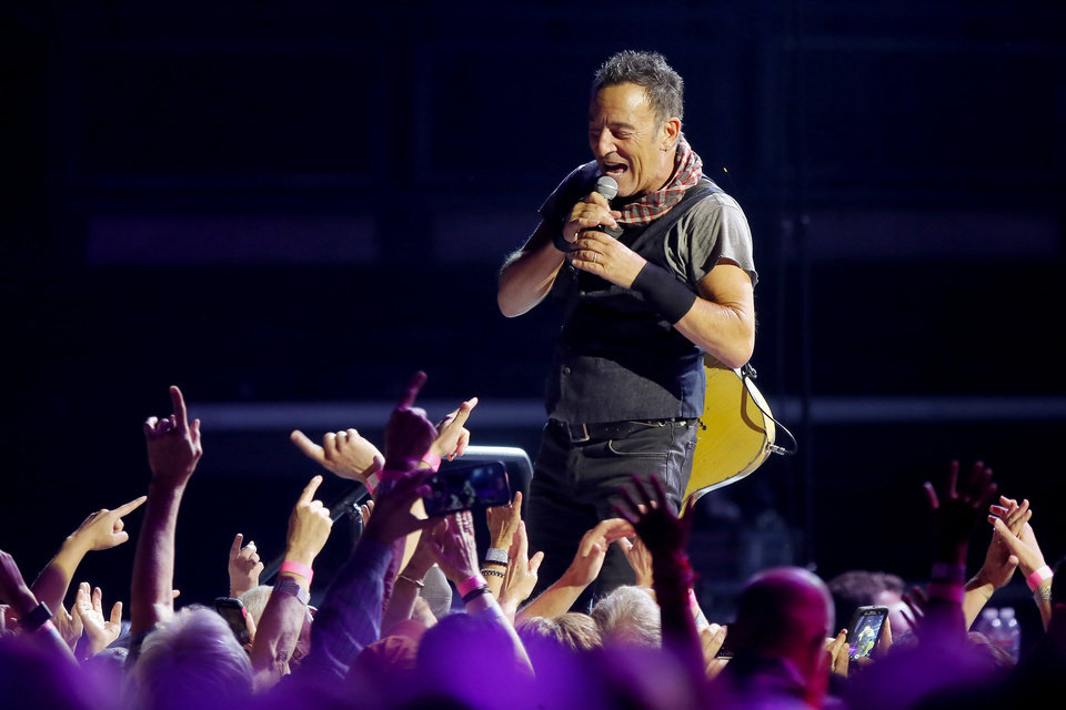 Photo -  Bruce Springsteen performs with the E Street Band on April 3 during a concert at Chesapeake Energy Arena in Oklahoma City. [Photo by Bryan Terry, The Oklahoman]