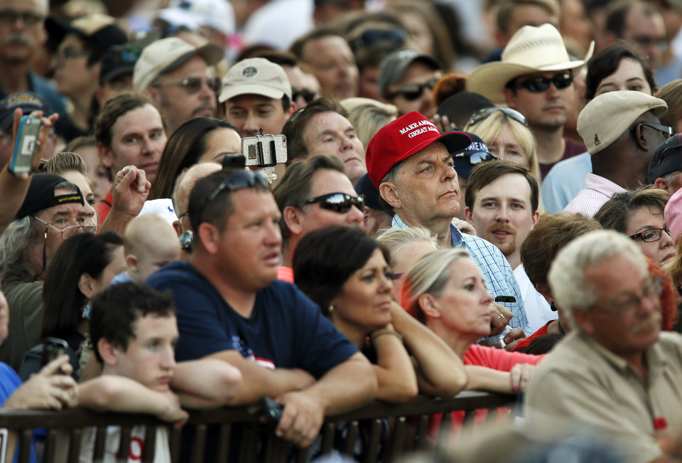 Photo - People listen to Republican presidential candidate Donald Trump during a rally at the Oklahoma State Fair at State Fair Park in Oklahoma City, Friday, Sept. 25, 2015. Photo by Nate Billings, The Oklahoman