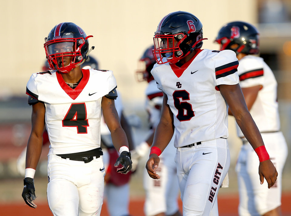 Photo - Del City's Kyshon Murray (4) and Donavan Stephens (6) line up for a play during the high school football game between Carl Albert and Del City at Carl Albert High School in Midwest City, Okla., Friday, Sept. 13, 2019. [Sarah Phipps/The Oklahoman]