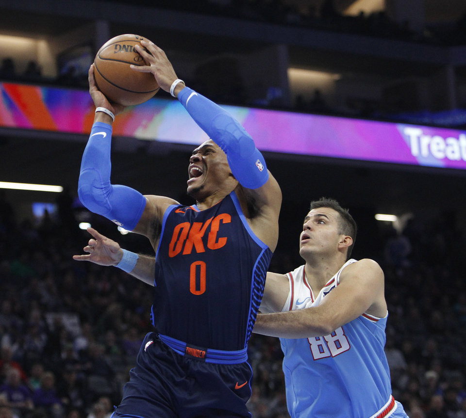 52b5df7e9dc8 Oklahoma City Thunder guard Russell Westbrook (0) drives to the basket  against Sacramento Kings forward Nemanja Bjelica (88) during the first half  of an NBA ...