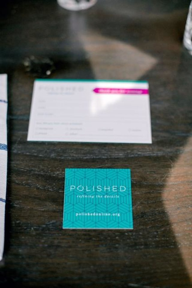 Photo -  Brochures containing information about the outreach ministry called Polished are shown on a table at Packard's. [Water and Grace Photography]
