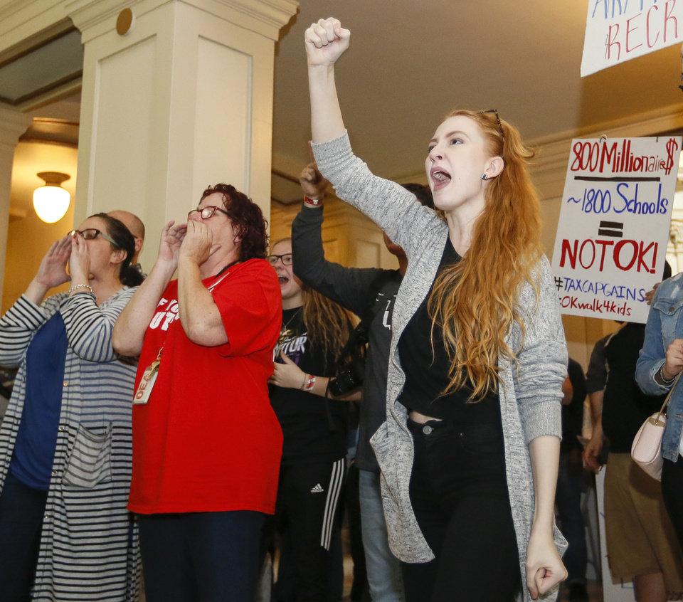 Photo - Morgan Brown, right, a student teacher at Westmoore High School, chants with others outside the House chamber during the eighth day of a walkout by Oklahoma teachers at the state Capitol in Oklahoma City, Monday, April 9, 2018. Photo by Nate Billings, The Oklahoman