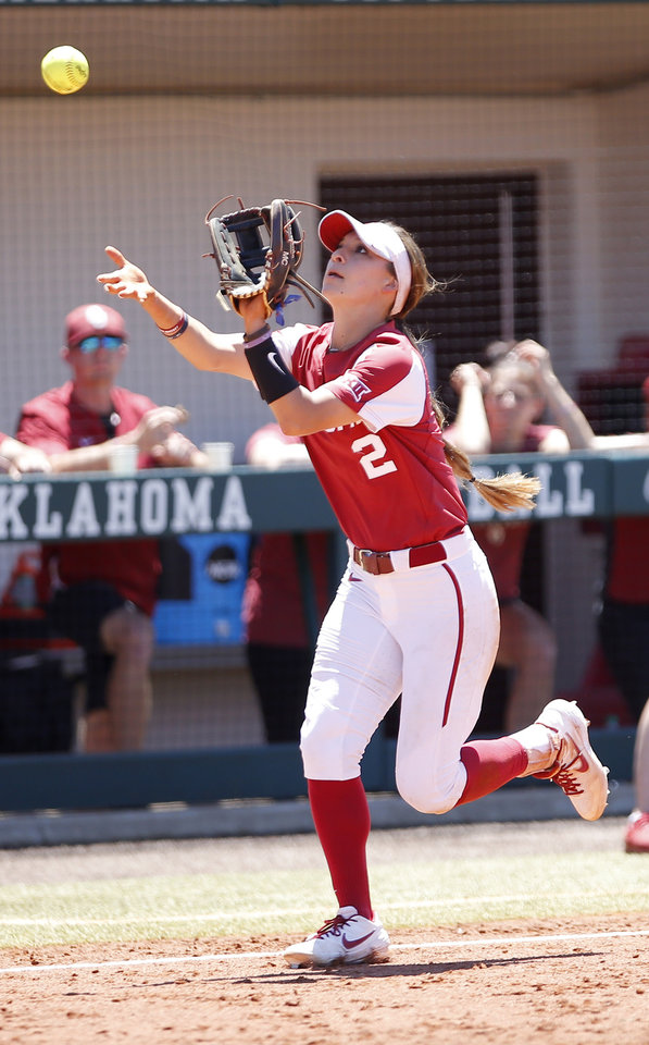 Photo - Oklahoma's Sydney Romero (2) makes a catch in the fourth inning during college softball game between Oklahoma and Wisconsin in the NCAA Norman Regional at Marita Hynes Field in Norman, Okla., Sunday, May 19, 2019 Photo by Sarah Phipps, The Oklahoman