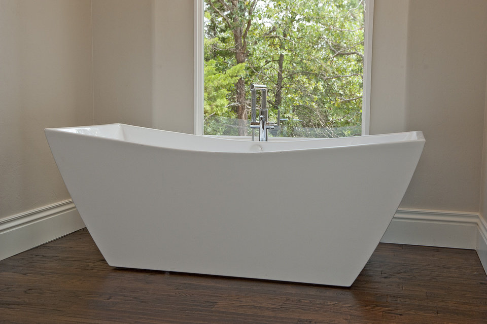 Inspirational Photo A sleek freestanding bathtub with a view is a feature of the home