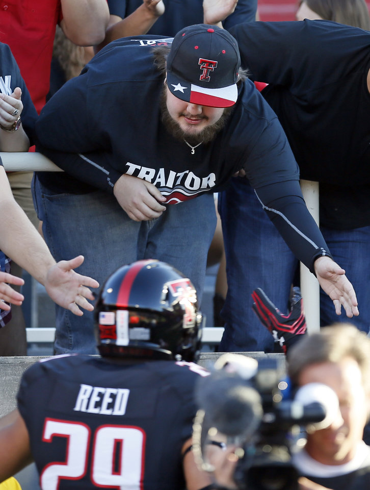 "Photo - Texas Tech fan Trey Parker wears a shirt that says ""traitor"" referencing OU quarterback Baker Mayfield before a college football game between the University of Oklahoma Sooners and Texas Tech Red Raiders at Jones AT&T Stadium in Lubbock, Texas, Saturday, Oct. 22, 2016. Photo by Nate Billings, The Oklahoman"