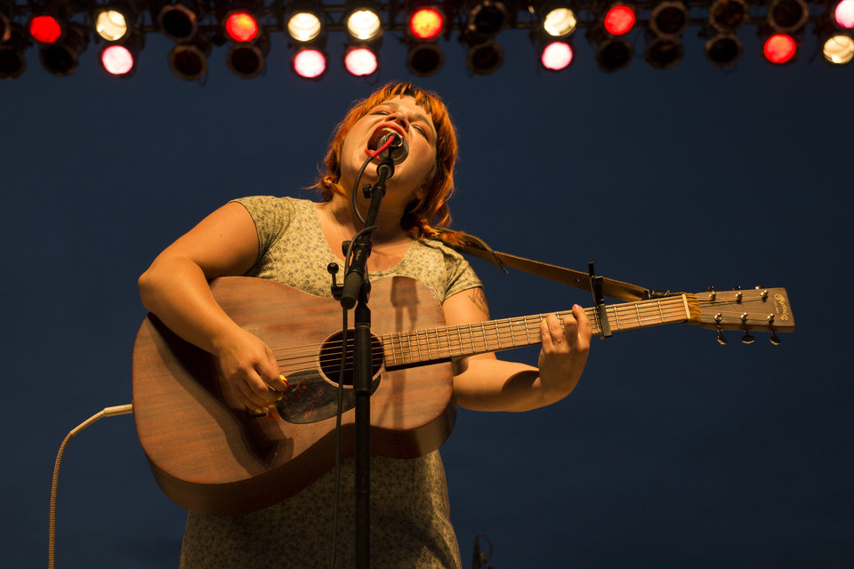 Photo -  Samantha Crain performs at WoodyFest on the new permanent stage in the Pastures of Plenty. [Photo by Nathan Poppe, The Oklahoman]