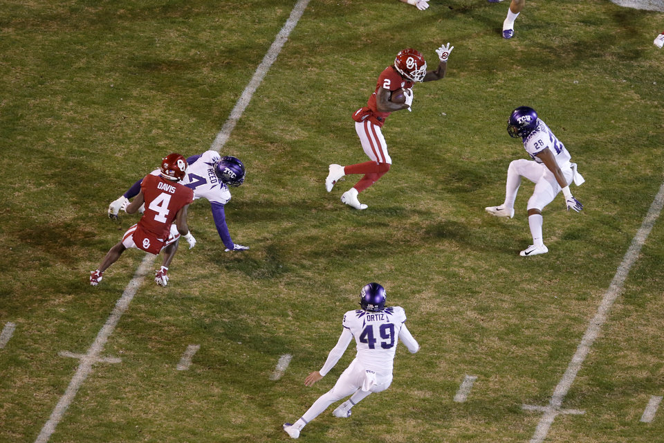 Photo - Oklahoma's CeeDee Lamb (2) returns a punt during an NCAA football game between the University of Oklahoma Sooners (OU) and the TCU Horned Frogs at Gaylord Family-Oklahoma Memorial Stadium in Norman, Okla., Saturday, Nov. 23, 2019. Oklahoma won 28-24. [Bryan Terry/The Oklahoman]