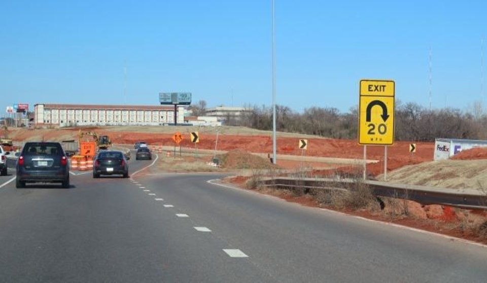 Photo -  The exit to go westbound on I-44 from northbound I-235 is only marked with an exit sign. Construction at I-235 and I-44 junction has caused most of the directional signs to be removed temporarily, leaving confusion. [Doug Hoke/The Oklahoman]