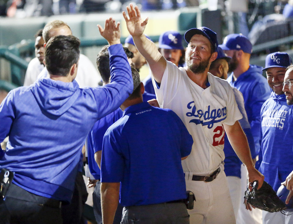 Photo - Clayton Kershaw gives high fives in the dugout after pitching four and a third innings in a rehab start for Oklahoma City, in the fifth inning of a minor league baseball game between the San Antonio Missions and the Oklahoma City Dodgers at the Chickasaw Bricktown Ballpark in Oklahoma City, Thursday, April 4, 2019. Photo by Nate Billings, The Oklahoman
