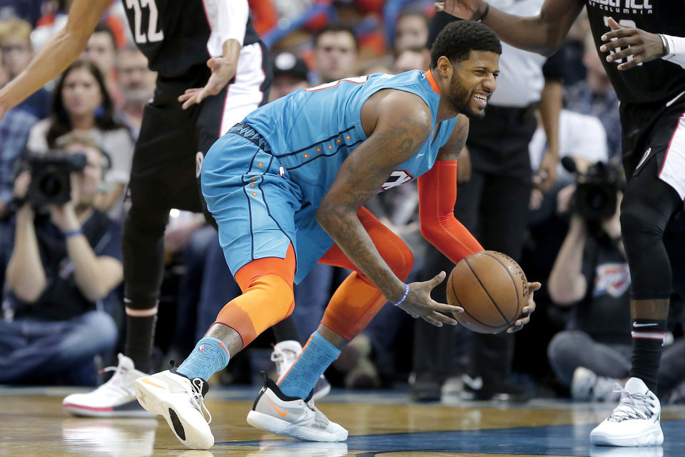 Photo - Oklahoma City's Paul George (13) grimaces as he picks up his dribble during an NBA basketball game between the Oklahoma City Thunder and the Washington Wizards at Chesapeake Energy Arena in Oklahoma City, Sunday, Jan. 6, 2019. Photo by Bryan Terry, The Oklahoman