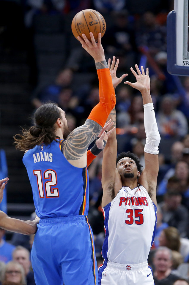 Photo - Oklahoma City's Steven Adams (12) shoots over Detroit's Christian Wood (35) during NBA basketball game between the Oklahoma City Thunder and the Detroit Pistons at the Chesapeake Energy Arena in Oklahoma City, Friday, Feb. 7, 2020.  [Sarah Phipps/The Oklahoman]