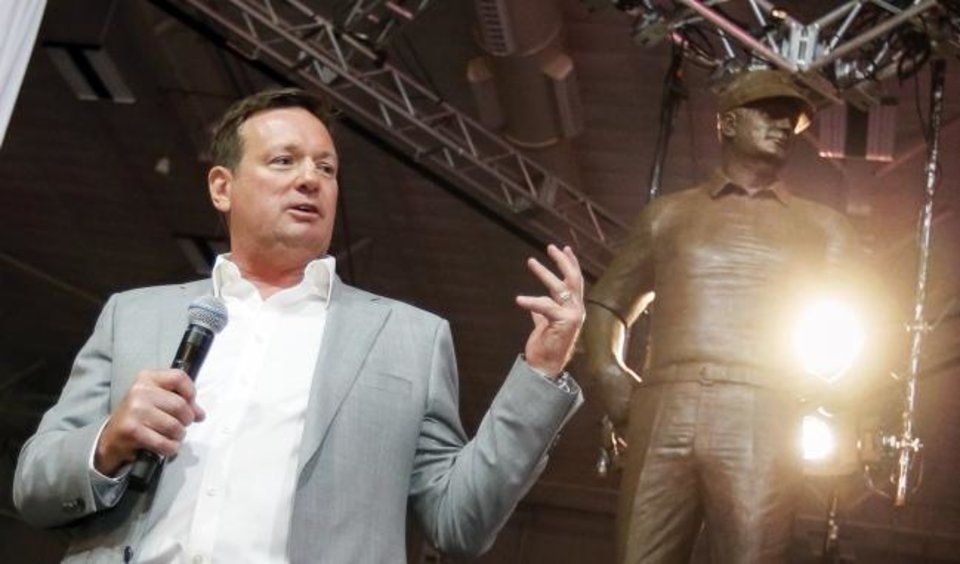 Photo -  Former OU football coach Bob Stoops speaks after his statue is unveiled during the Salute to Stoops event April 13, 2018, in Oklahoma City. [Nate Billings/The Oklahoman archives]