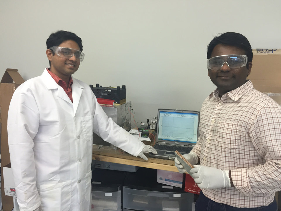 Photo - Dr. Arif Rahman, Research Scientist, and Dr. Saravan Kumar, Director of Research, test material samples.