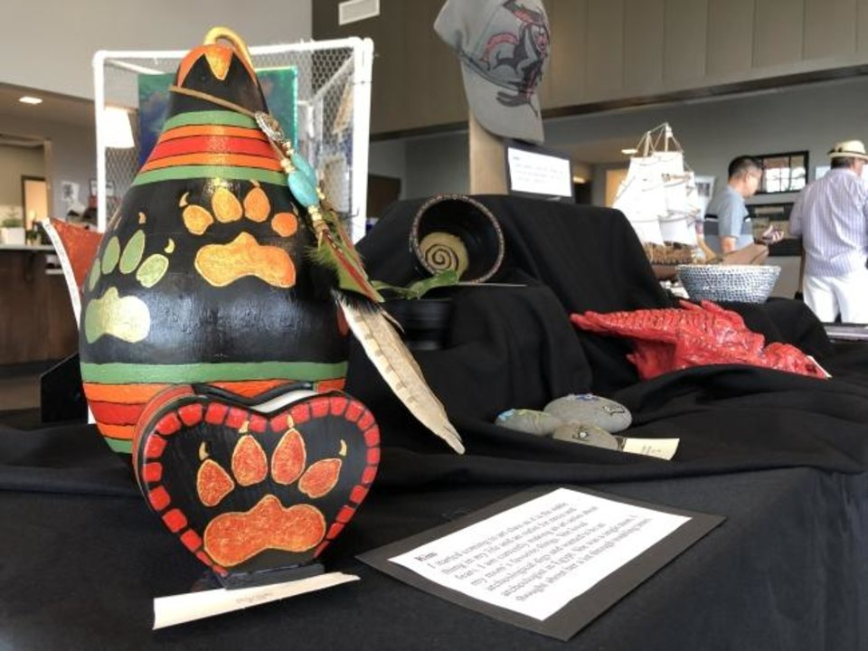 Photo -  A piece by Fresh StART artist Kim is among items on display at Friday's art show at the Homeless Alliance. She dedicated multiple pieces to her late mother. [Kayla Branch/The Oklahoman]