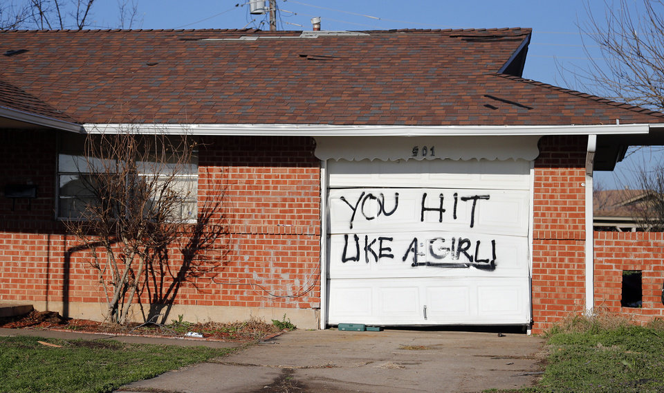 Photo - A resident  in Moore, Okla. spray painted a message on their garage door in response to the tornado that hit the on Thursday, March 26, 2015. A tornado hit the area on Wednesday evening causing damage in the area.  Photo by Chris Landsberger, The Oklahoman
