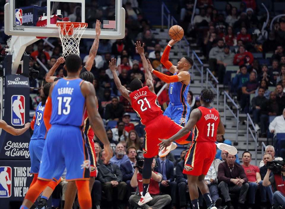 Oklahoma City Thunder guard Russell Westbrook (0) shoots against New  Orleans Pelicans forward Darius Miller (21) in the second half of an NBA  basketball ... a4cc4967a