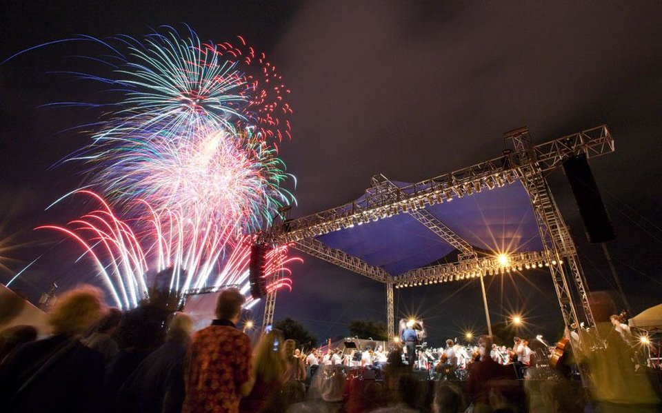 "Photo -  Fireworks explode as the Oklahoma City Philharmonic plays ""Stars and Stripes Forever"" for the finale of their free Patriotic Pops concert during the Independence Day celebration Red, White, and Boom! east of the Bricktown Ballpark in Oklahoma City, Saturday, July 3, 2010. Photo by Nate Billings, The Oklahoman"