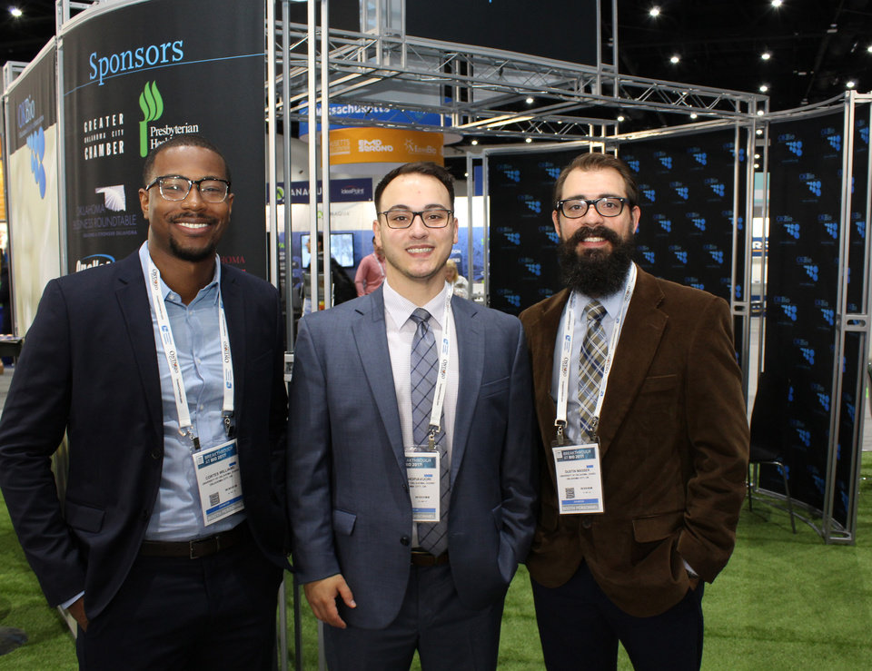 Photo -  University of Oklahoma Venture Fellows, from left, Cortes Williams, Blake Hopiavuori and Dustin Masser are seen at the 2017 BIO show in San Diego on Wednesday. [Photos by Jim Stafford, for The Oklahoman]