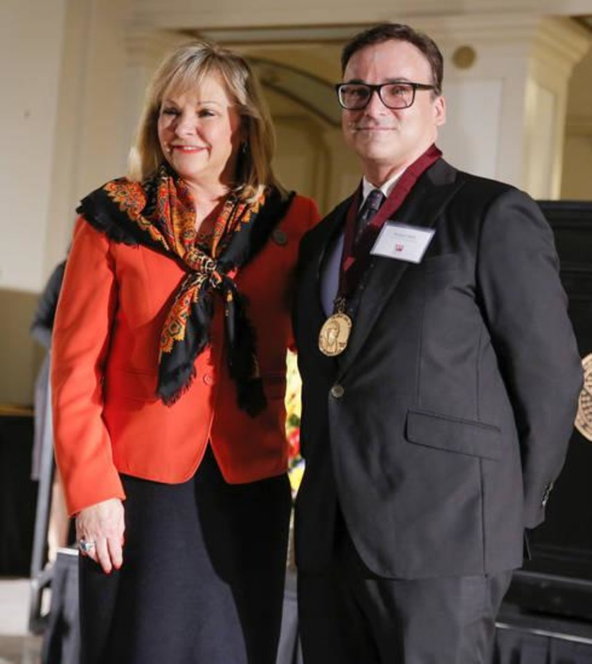 Photo - Robert Mills, artistic director for Oklahoma City Ballet, poses for a photo with Gov. Mary Fallin after receiving the Community Service Award during the Governor's Arts Awards at the state Capitol in Oklahoma City, Wednesday, Feb. 28, 2018. [Photo by Nate Billings, The Oklahoman Archives]