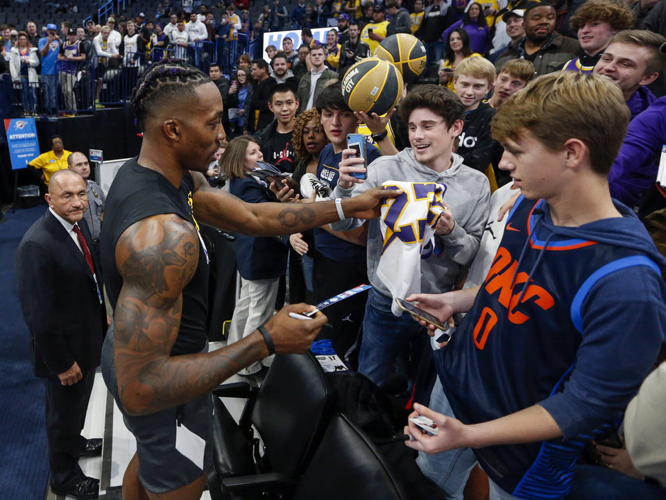Photo - Los Angeles' Dwight Howard (39) signs autographs and takes pictures with fans before an NBA basketball game between the Oklahoma City Thunder and the Los Angeles Lakers at Chesapeake Energy Arena in Oklahoma City, Friday, Nov. 22, 2019. [Nate Billings/The Oklahoman]