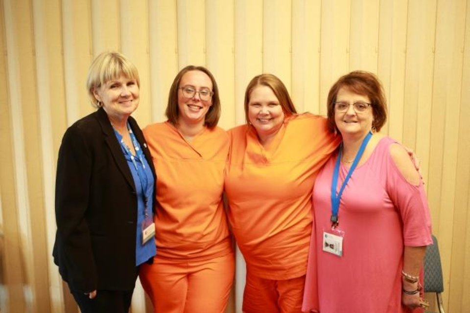 Photo -  Tammy Franklin, Prison Fellowship Academy program manager, poses for a picture with academy graduates Laura Tustin and Charlene Davis and volunteer Terri Grewell after an academy graduation at Kate Barnard Correctional Center. [Charles Prince/Prison Fellowship]