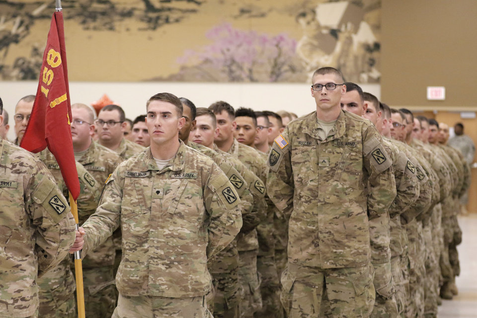 Photo -  Members of the Oklahoma Army National Guard Battery B, 1st Battalion, 158th Field Artillery, 45th Field Artillery Brigade stand at parade rest Friday during their homecoming ceremony in Mustang. The guardsman were returning from deployment to Afghanistan in support of Operation Enduring Freedom. Photo By Steve Gooch, The Oklahoman   Steve Gooch -