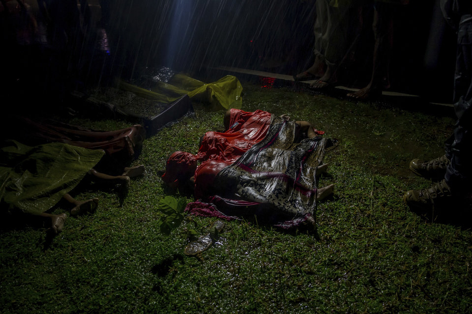 Image result for Bodies of Rohingya Muslim children, who died after their boat capsized in the Bay of Bengal as they were crossing over from Myanmar into Bangladesh, lie on a roadside near Inani beach near Cox's Bazar, Bangladesh, Sept. 28, 2017.