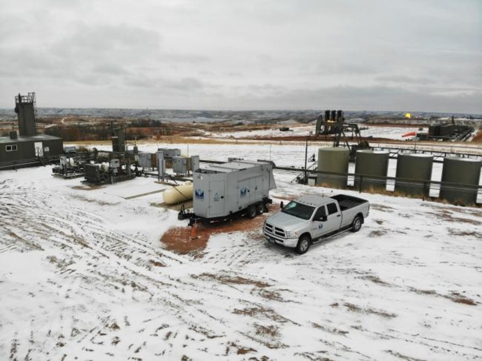 Photo -  A Mesa Natural Gas Solutions generator is seen on a remote location in North Dakota's Bakken Shale field. The company got its start offering affordable, reliable power to oil and gas operators in shale plays. [PROVIDED]