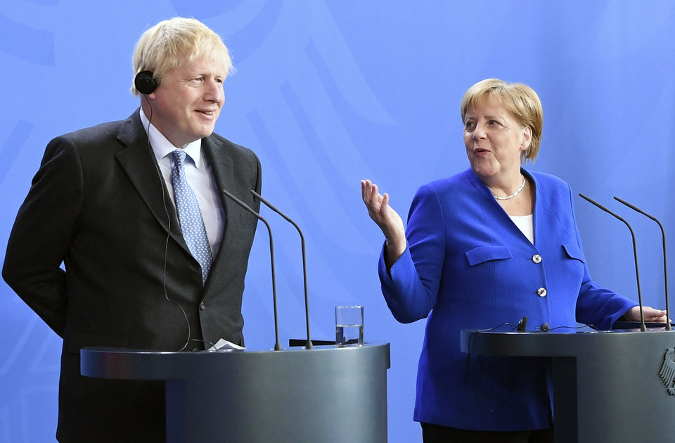 Photo -  Germany's Chancellor Angela Merkel and British Prime Minister Boris Johnson attend a joint press conference, in Berlin, Wednesday, Aug. 21, 2019. German Chancellor Angela Merkel says she plans to discuss with UK Prime Minister Boris Johnson how Britain's exit from the European Union can be