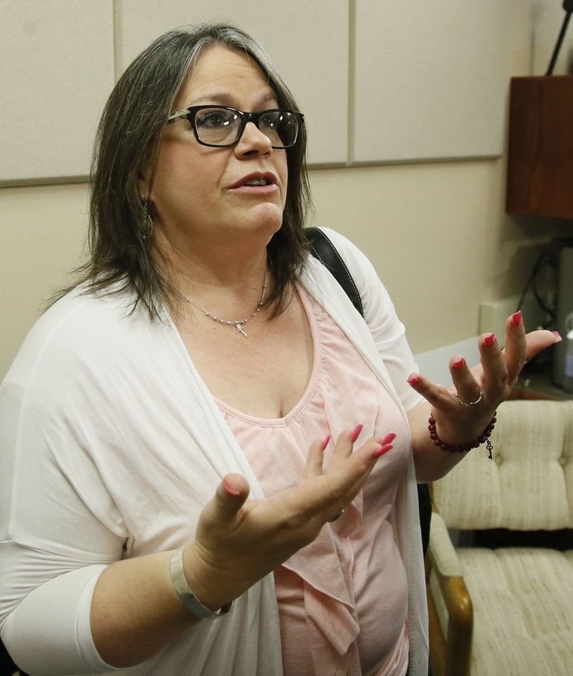 Photo -  Elise Robillard gestures as she answers a question following a news conference Thursday concerning the impact of payday and predatory loans. Leaders from some of Oklahoma's churches, nonprofits and Native American tribes are among those calling for changes to the state's payday loan industry that they say preys on low-income residents and keeps them trapped in a cycle of debt. Robillard, says she fell into a cycle of taking short-term, high-interest loans that ultimately led her to declare bankruptcy. (AP Photo/Sue Ogrocki)