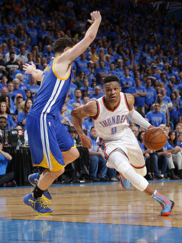 Photo - Oklahoma City's Russell Westbrook (0) drives to the basket as Golden State's Klay Thompson (11) defends during Game 6 of the Western Conference finals in the NBA playoffs between the Oklahoma City Thunder and the Golden State Warriors at Chesapeake Energy Arena in Oklahoma City, Saturday, May 28, 2016. Photo by Sarah Phipps, The Oklahoman