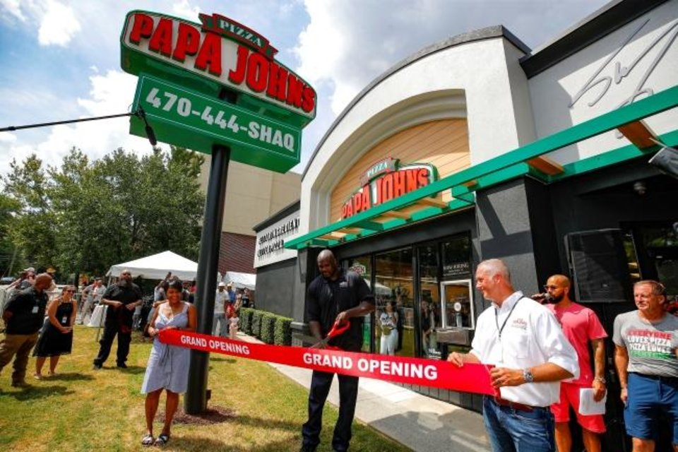 Photo -  Mayor Keisha Lance Bottoms and Papa John's CEO Steve Ritchie join franchisee Shaquille O'Neal in opening one of his nine Atlanta area restaurants in 2019. [Todd Kirkland/AP Images for Papa John's]