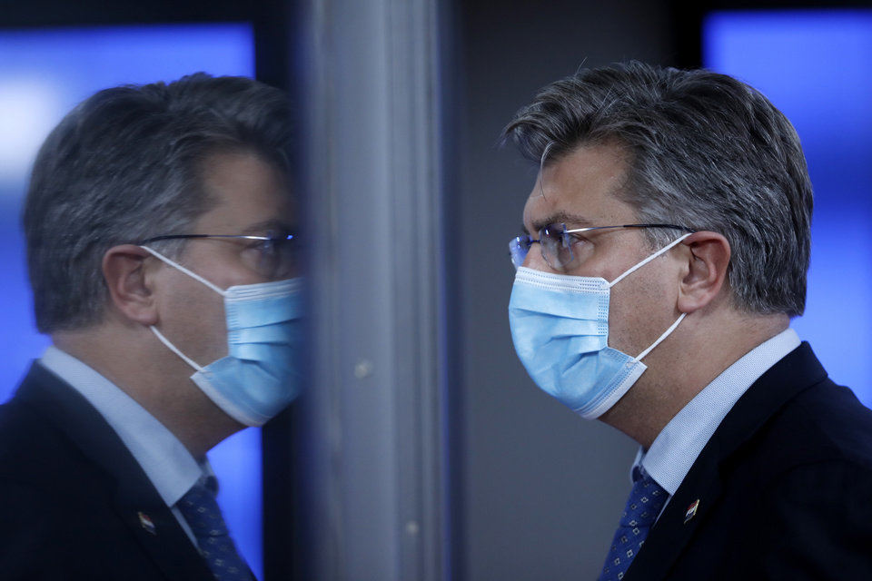 Photo -  Croatia's Prime Minister Andrej Plenkovic is reflected in a glass door as he leaves during departures at an EU summit in Brussels, Thursday, Oct. 15, 2020. European Union leaders met in person for the first day of a two-day summit, amid the worsening coronavirus pandemic, to discuss topics ranging from Brexit to climate and relations with Africa. (AP Photo/ Francisco Seco, Pool)