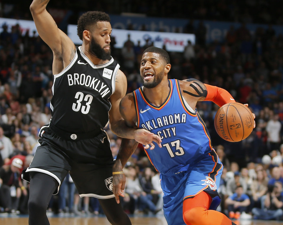 Photo - Oklahoma City's Paul George (13) goes past Brooklyn's Allen Crabbe (33) during an NBA basketball game between the Oklahoma City Thunder and the Brooklyn Nets at Chesapeake Energy Arena in Oklahoma City, Wednesday, March 13, 2019. Oklahoma City won 108-96. Photo by Bryan Terry, The Oklahoman
