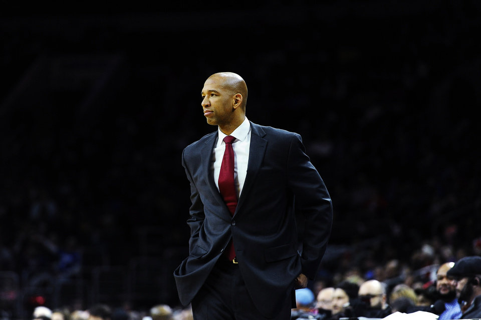 Photo - New Orleans Pelicans head coach Monty Williams is seen during an NBA basketball game against the Philadelphia 76ers on Friday, Jan. 16 2015, in Philadelphia. (AP Photo/Michael Perez)
