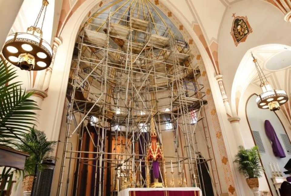 Photo -  A maze of scaffolding rises above the altar as crews repair the interior of St. Joseph Old Cathedral, 307 NW 4. in downtown Oklahoma City. [Jim Beckel/ The Oklahoman]