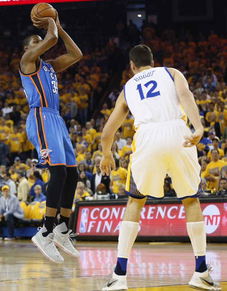 Photo - Oklahoma City's Kevin Durant (35) shoots over Golden State's Andrew Bogut (12) during Game 5 of the Western Conference finals in the NBA playoffs between the Oklahoma City Thunder and the Golden State Warriors at Oracle Arena in Oakland, Calif., Thursday, May 26, 2016. Photo by Nate Billings, The Oklahoman