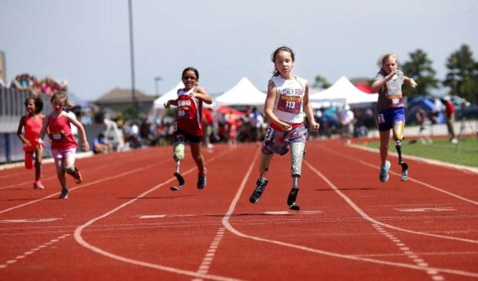 Photo -  Ellie Todd competes in the 200-meter dash Saturday during the during the Endeavor Games at Edmond North High School. [Sarah Phipps/The Oklahoman]