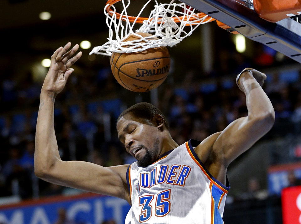 Photo - Thunder's Kevin Durant (35) scores during the NBA basketball game between the Oklahoma City Thunder and the Minnesota Timberwolves at Chesapeake Energy Arena on March 11, 2016 in Oklahoma City, Okla. Photo by Steve Sisney, The Oklahoman