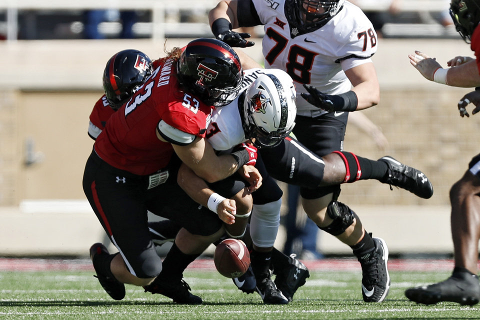 Photo - Texas Tech's Eli Howard (53) forces a fumble as he sacks Oklahoma State's Spencer Sanders (3) during the first half of the NCAA college football game Saturday, Oct. 5, 2019, in Lubbock, Texas. (AP Photo/Brad Tollefson)