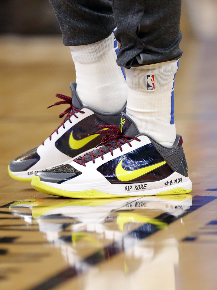 Photo - Dallas' Luka Doncic (77) honored NBA legend Kobe Bryant of the Los Angeles Lakers, his daughter Gianna and the seven others killed in a helicopter crash on Sunday with writing on his shoes, during an NBA basketball game between the Oklahoma City Thunder and Dallas Mavericks at Chesapeake Energy Arena in Oklahoma City, Monday, Jan. 27, 2020. Dallas won 107-97. [Nate Billings/The Oklahoman]