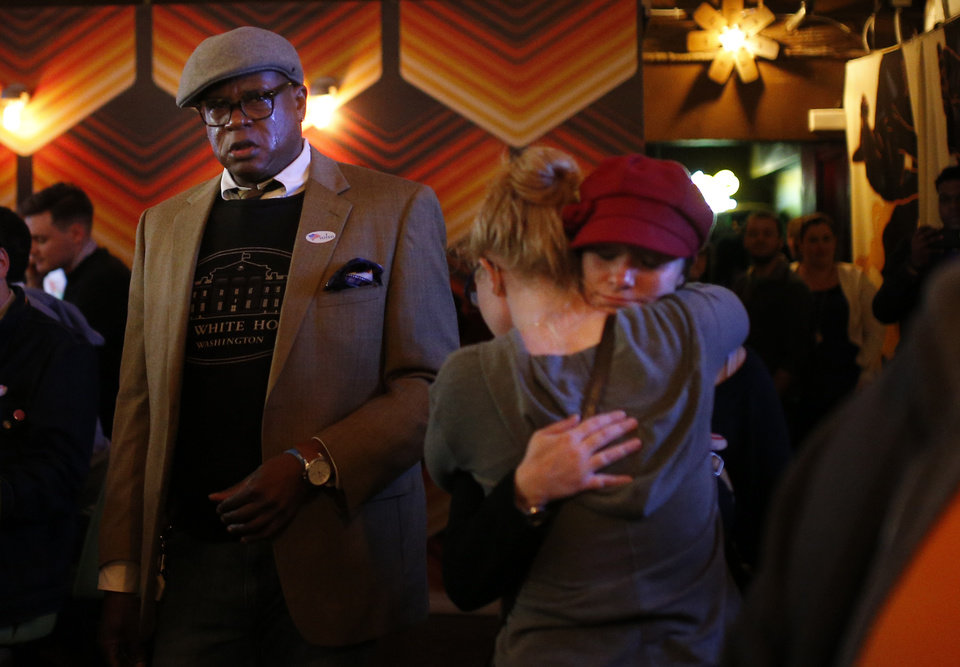Photo - People react as they watch results of the 2016 election. Democratic Party supporters gathered Tuesday night at Rockford Cocktail Den in Oklahoma City to await election results in the 2016 presidential contest pitting Hillary Clinton against GOP candidate Donald Trump. Oklahomans on Tuesday also cast votes on several state ballot measures, a host of legislative contests and other local issues and offices. Photo by Sarah Phipps, The Oklahoman
