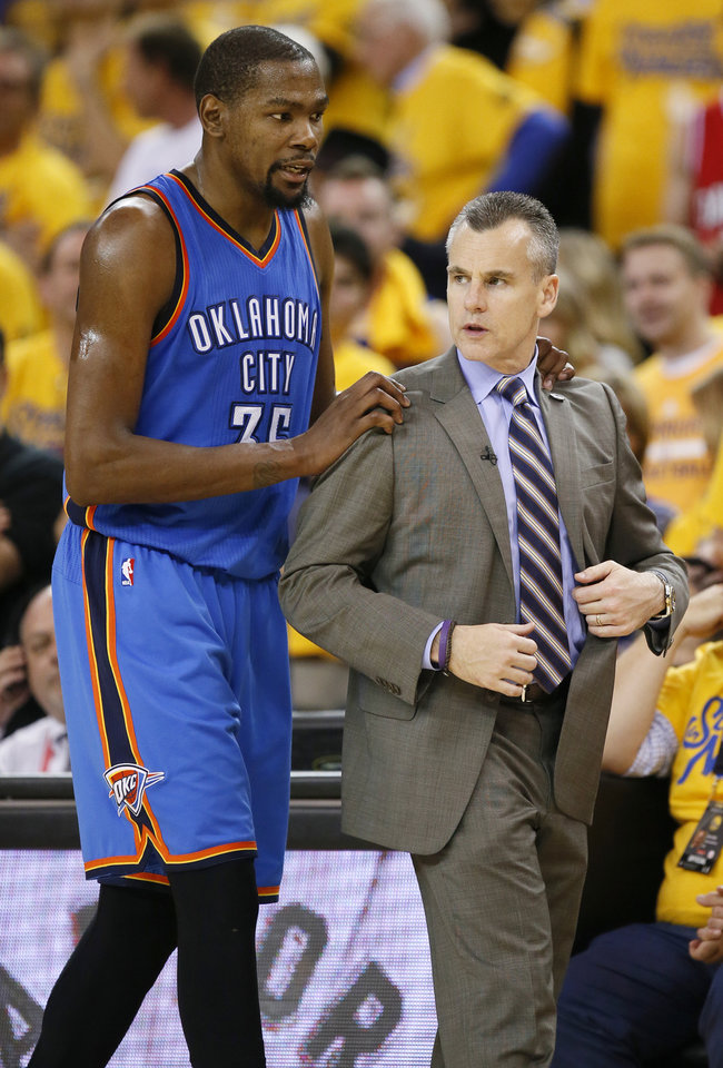 Photo - Oklahoma City's Kevin Durant (35) talks to coach Billy Donovan late in the fourth quarter during Game 5 of the Western Conference finals in the NBA playoffs between the Oklahoma City Thunder and the Golden State Warriors at Oracle Arena in Oakland, Calif., Thursday, May 26, 2016. The Warriors won 120-111. Photo by Nate Billings, The Oklahoman